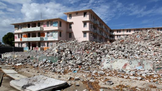Debris is scattered around the government housing project Puerta de Tierra which is undergoing renovation work, in San Juan, December 2, 2015.