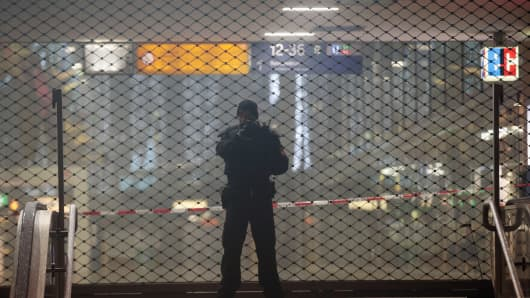 A police officer guards the southern entrance to Munich's main station