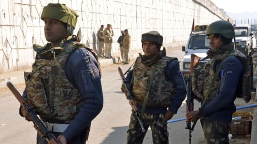 Indian security personnel stand alert on a road leading to an airforce base in Pathankot on January 2, 2016. Suspected Islamist gunmen have staged a pre-dawn attack on a key Indian air base near the Pakistan border.