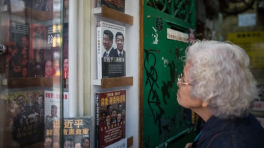 An elderly lady looks into a shop display of the Causeway Bay Books store in Hong Kong.