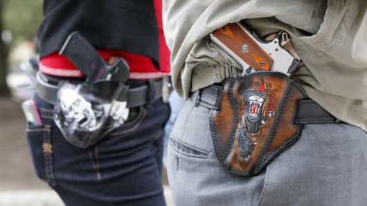 Art and Diana Ramirez of Austin with their pistols in custom-made holsters during and open carry rally at the Texas State Capitol on January 1, 2016 in Austin, Texas. On January 1, 2016, the open carry law takes effect in Texas, and 2nd Amendment activists hold an open carry rally.