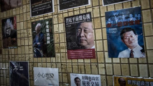 Posters of books about China's politics including some featuring Chinese President Xi Jinping are seen displayed in the staircase leading to a bookshop in Hong Kong.