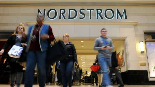 Customers exit a Nordstrom department store in Christiana, Delaware.