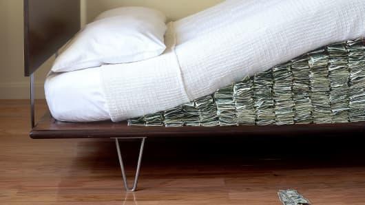 money hidden under modern bed mattress