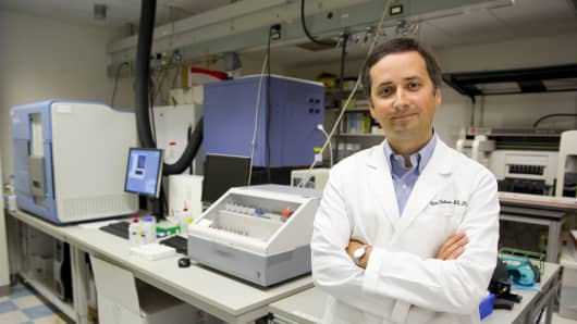 Victor Velculescu, a researcher at Johns Hopkins University School of Medicine, is shown in a lab at the Johns Hopkins Kimmel Cancer Center where DNA samples from blood are sequenced to detect cancer-related mutations.