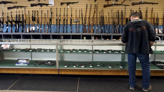 A customer looks over weapons for sale at the Pony Express Firearms shop in Parker, Colorado December 7, 2015.