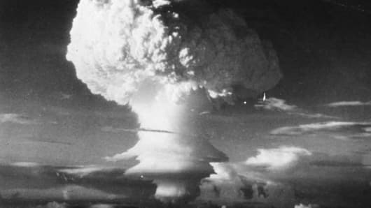 Characteristic mushroom shaped cloud begins formation after the first H-Bomb explosion (US) at Eniwetok Atoll in the Pacifi on 6th November 1952.
