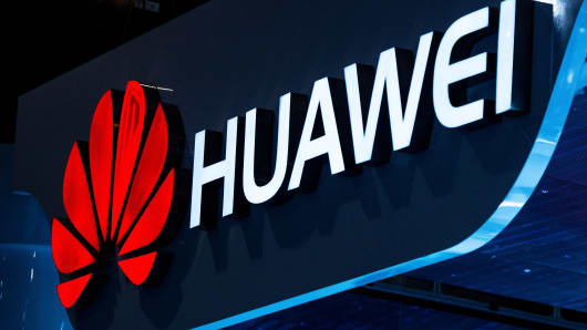 A logo sits illuminated outside the Huawei pavilion during Mobile World Congress 2015 in Barcelona, Spain.