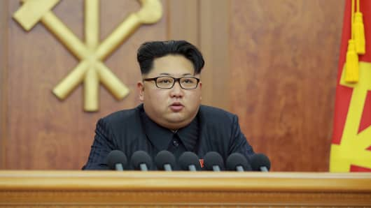North Korean leader Kim Jong Un gives a New Year's address for 2016 in Pyongyang, in this undated photo released by Kyodo January 1, 2016. North Korean leader Kim Jong Un blamed South Korea on Friday for increased mistrust in a New Year speech after a year of heightened tension between the rival countries.