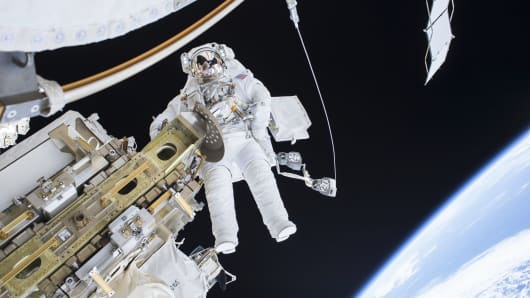 Expedition 46 Flight Engineer Tim Kopra performs a spacewalk outside the International Space Station in this December 21, 2015 NASA handout photo.