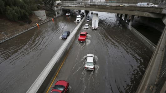 Vehicles drive on the flooded 5 freeway after an El Nino-strengthened storm brought rain to Los Angeles, California, United States, January 6, 2016.