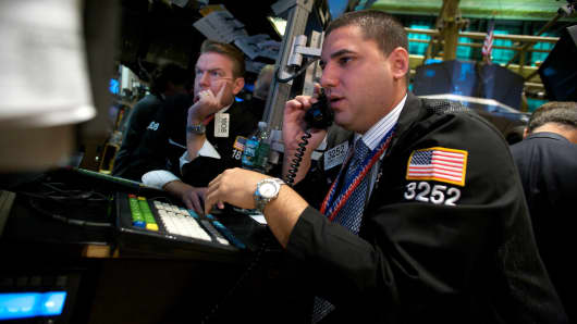 Traders work on the floor of the New York Stock Exchange in New York, U.S.