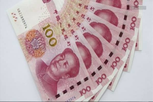 China FX reserves fall $512B in 2015
