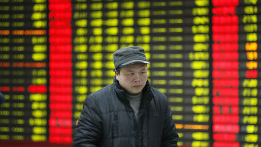 An investor observes stock market prices on January 7, 2016 in Huaibei, China.