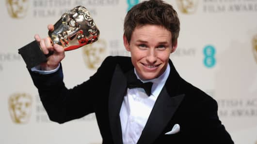 Eddie Redmayne poses in the winners room at the EE British Academy Film Awards at The Royal Opera House on February 8, 2015.