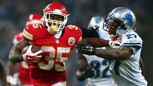 Charcandrick West #35 of the Kansas City Chiefs looks to hold off Glover Quin #27 of the Detroit Lions during the NFL game between Kansas City Chiefs and Detroit Lions at Wembley Stadium on November 01, 2015 in London.
