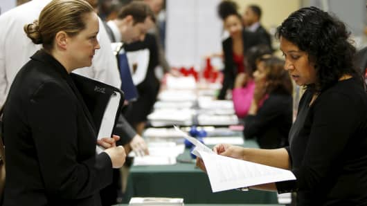 "Moushumi Paul (R) of the USDA interviews job applicant Sherry Rose (L) at a U.S. Chamber of Commerce Foundation ""Hiring Our Heroes"" military job fair in Washington."