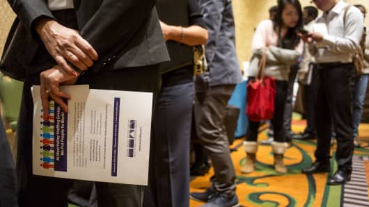 Job seekers wait in line to speak with recruiters during the San Jose Career Fair in San Jose, California.