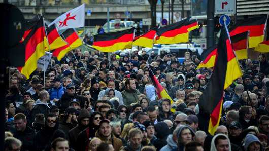 Supporters of right wing groups gather to protest in Cologne on January 9 over Germany's open-door policy for asylum seekers, which resulted in about 1.1 million migrants and refugees entering the country in 2015.