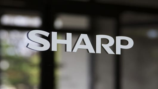 A Sharp Corp. logo is displayed on a door at the entrance to the company's plant in Yaita, Tochigi Prefecture, Japan, on Thursday, Nov. 19, 2015.