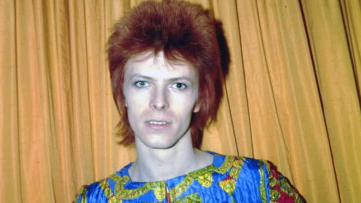 David Bowie poses for a portrait dressed as 'Ziggy Stardust' in a hotel room in 1973 in New York City.