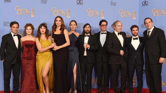 Actors, producers and the production team members from 'Mozart in the Jungle,' pose during the 73rd Annual Golden Globe Awards.