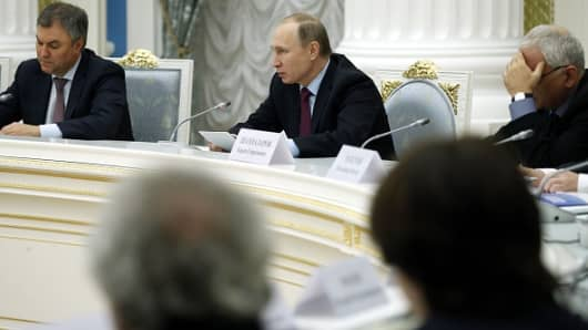 Russian President Vladimir Putin (C) speaks at a meeting of the Presidential Council for Culture and Art at the Kremlin in Moscow on December 25, 2015.