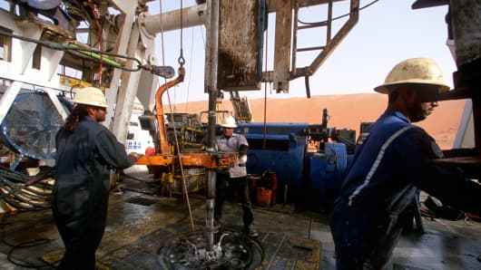 Workers drill at the Saudi Aramco oil field complex facilities in Shaybah, Saudi Arabia.