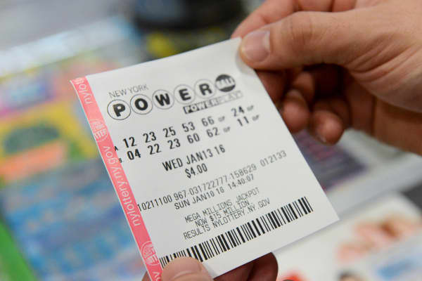 A person in New York holds a Powerball ticket