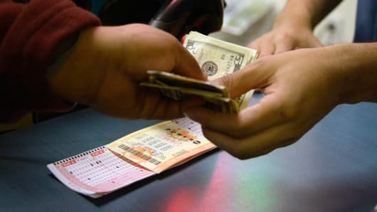Customers purchase tickets for the Powerball lottery