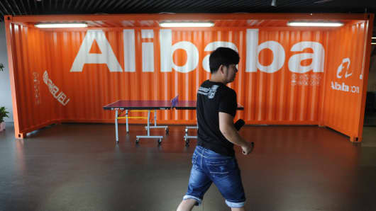 An Alibaba employee walks through a communal space at the company's headquarters in Hangzhou, China.