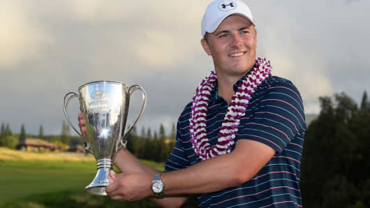 Jordan Spieth poses with the winner's trophy at the Hyundai Tournament of Champions on January 10, 2016 in Kapalua, Maui, Hawaii.