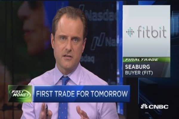 Final Trade: Altria, Fitbit, & more