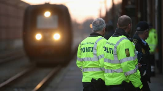 Danish policeman prepare to board a train arriving from Germany in order to check the identity papers of passengers on January 6, 2016 in Padborg, Denmark.