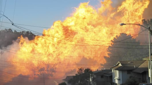 In this Sept. 9, 2010 file photo, a massive fire roars through a mostly residential neighborhood in San Bruno, Calif. On Friday, April 26, 2013, the cities of San Bruno and San Francisco, PG&E and consumer advocates are to file briefs on what they think PG&E should be fined for the San Bruno gas pipeline explosion that killed eight people in 2010.
