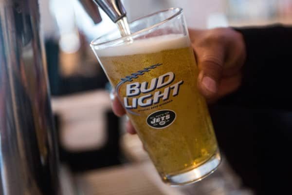 A Bud Light beer, a product of InBev, is poured from the tap at a bar in New York City.