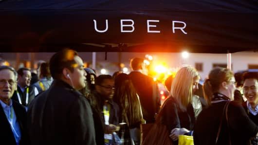 Attendees wait for rides in the Uber Technologies area during the 2016 Consumer Electronics Show in Las Vegas.