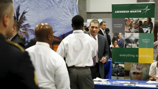 "A Lockheed Martin talent acquisition manager greets job applicants at a U.S. Chamber of Commerce Foundation ""Hiring Our Heroes"" military job fair in Washington January 8, 2016."