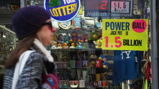 A sign advertises the Powerball jackpoy outside of a magazine store on January 13, 2016 in New York City. After no winners were declared in recent drawings, Wednesday night's $1.5-billion jackpot is the biggest in lottery history. Powerball is played in 44 states and three U.S. territories.