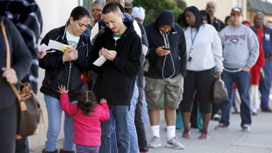 People line up to buy Powerball lottery tickets in Los Angeles.