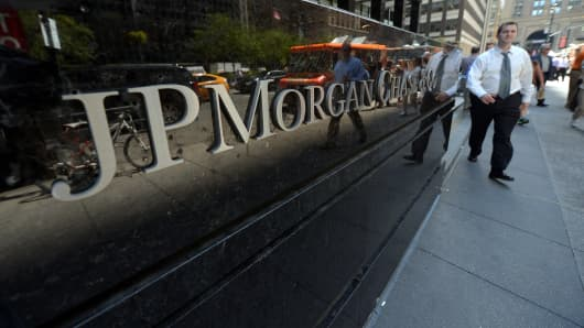 People walk by JP Morgan Chase & Company headquarters in New York.