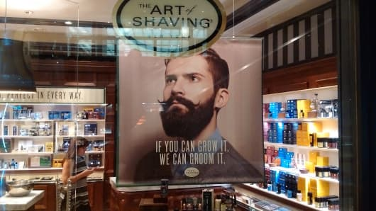A poster displayed the window of The Art of Shaving store in New York City.
