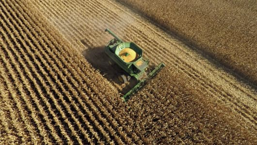 Non-GMO corn is harvested with a John Deere & Co. 9670 STS combine harvester in this aerial photograph taken above Malden, Illinois