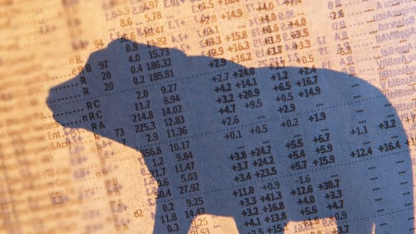 Stock quotes and silhouette of a bear