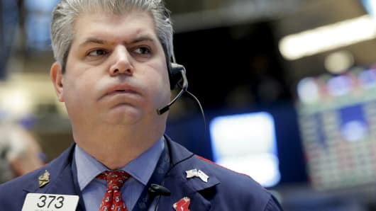 A trader on the floor of the New York Stock Exchange, January 15, 2016.