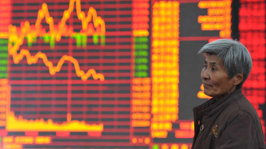 Shareholders observe the stock market at a stock exchange corporation in Nantong, China.