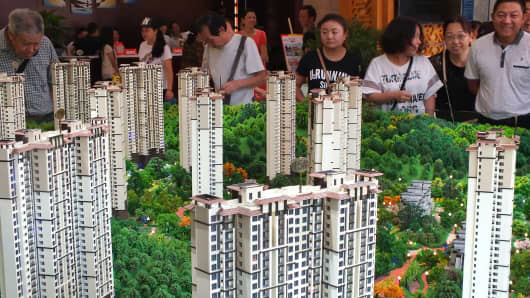 Chinese home buyers visit a housing fair in Yichang, in China's Hubei province, on Oct. 1, 2015. China has soared almost to the top of the world's economic league tables, but now growth is lagging.