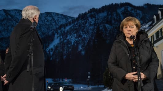 Bavarian Governor and Chairman of the Bavarian Christian Democrats (CSU) Horst Seehofer (L) and Angela Merkel German Chancellor speak during a press conference after the annual meeting of the CSU at Wildbad-Kreuth on January 6, 2015 in Kreuth, Germany.