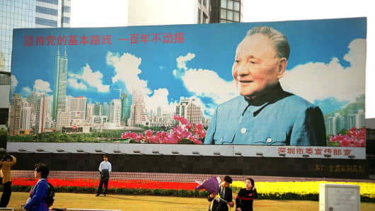 The huge billboard of the late patriarch Deng Xiaoping, the architect of China's economic reform program, takes center stage at a busy intersection in Shenzhen, southern China's special economic zone (SEZ). The billboard commemorates Deng's famous 1992 tour of southern China's econo