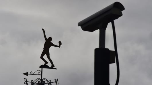 A CCTV camera is seen near a tennis player-shaped weather vane at the All England Lawn Tennis Club, where the Wimbledon Tennis Championships take place, in south London, Britain January 18, 2016. World tennis was rocked on Monday by allegations that the game's authorities have failed to deal with widespread match-fixing.